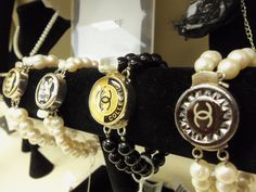 We carry Chanel Button Jewelry!