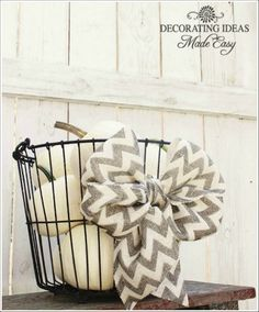 Chevron Bow and a basket full of white pumpkins. Fall Decorating Ideas To Make Your Home Gorgeous This Autumn!