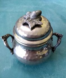 Hammered pewter sugar bowl with lid.