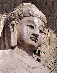 A close-up of one of the central figure from Fengxian Monastery at Longmen, completed during the first half of the eighth century.