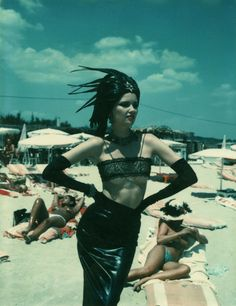Model in leather on the beach in St. Tropez, 1978.  Photo by Helmut Newton.