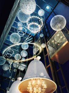 This is the breathtaking lobby of the Andaz Prinsengracht Hotel in Amsterdam.  It has a multi-level glass wall with clusters of floating crystal pendants.