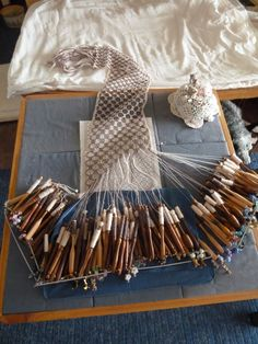 Cashmere bobbin lace scarf using well over 60 pairs of bobbins on lace pillow by teddybearmargaret