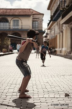 Children play baseball in Plaza Vieja, one of the main squares in the old town of Havana