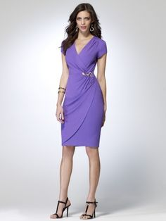 Cap sleeve faux wrap dress with golden snake hardware at waist. Gathering at shoulder. 38 inch body length92% rayon, 8% spandexDomesticDry clean only Select colors on SALE