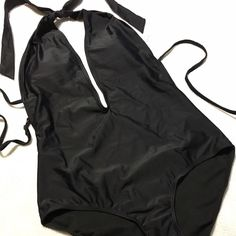 Black one pice bathing suit ☀️⚫️ Never got around to use this one. Has perfect padding up top not bulky. Open back. Forever 21 Swim
