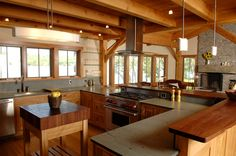 timberframe kitchen layout overlooking fireplace