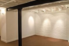 White walls, white ceiling basement. this is a perfect start to a makeshift basement play area