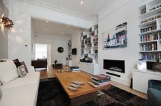 Fuhlam SW6 by MDSX Contractors    Like the book shelves