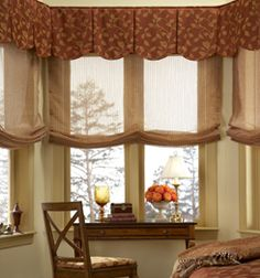Sheer Roman Shades filter light and allow the view to show through!  Valances frame out top and add color pop.