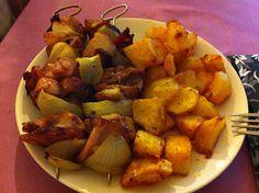 Pork skewer with potatoes