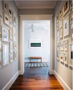 hallway decorated with all-white gallery frames