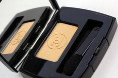 Chanel eyeshadow in gold to go with the red lipstick. I came across this combo as a teenager and still adore the look it gives - winged black eyeliner, a bit of sparkle, and a whole lot of personality.