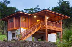 A stunning Hawaiian cottage for sale near the town of Kona. Situated on 5 acres, the one bedroom and one bathroom home offers stunning views of the Native Ohio Forest.