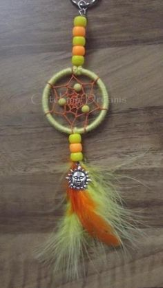 Yellow and Orange Dream Catcher Keyring/Bag Dangler, with Yellow beads incorporated into the inner design and a Sun charm added to the feather drop. Other colours available Dreamcatchers, Creative Crafts, Orange, Yellow, Feather, Craft Ideas, Colours, Drop, Sun