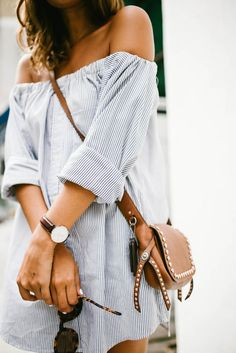 Pair your striped off the shoulder dress, with tortoiseshell sunglasses and a crossbody brown leather bag.