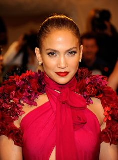 It's rare to see Jennifer in anything but her signature neutral lip look, but at the 2011 Met Gala, she coupled a fuchsia Gucci gown with a candy apple-red lipstick. Red Lip Makeup, Hair Makeup, Makeup Hairstyle, Hairstyle Ideas, Jennifer Lopez Movies, Gucci Gown, Celebrity Makeup, Celebrity Photos, Perfect Makeup