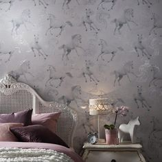 WOW - imagine this wallpaper in your pony mad childs bedroom! A beautiful horse themed wallpaper . This beautiful Glittering Grey Horse wallpaper features galloping horses in tones of soft grey and white on a background patterned with silver plum Grey Horse Wallpaper, Silver Wallpaper, Unique Wallpaper, Contemporary Wallpaper, Glitter Wallpaper, Animal Wallpaper, Horse Themed Bedrooms, Bedroom Themes, Horse Bedrooms