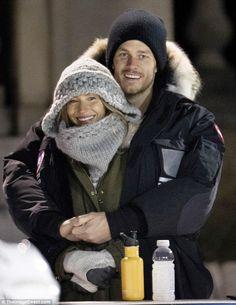 Body heat! Tom Brady and wife Gisele Bündchen found an affectionate way to stay warm at a Boston hockey match on Sunday