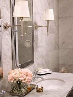 White marble bathroom with flowers