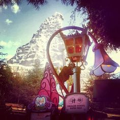 view of the matterhorn from alice in wonderland ride: via fydisneylove