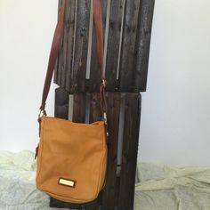 Steve Madden cross over Super cute cross body. It has been used. But still has lots of life left. There is some signs of wear on the strap. The strap is adjustable as well. On the bottom there is a zipper to expand which reveals brown material when expanded. Any questions please feel free to ask.⭐️ Steve Madden Bags Crossbody Bags