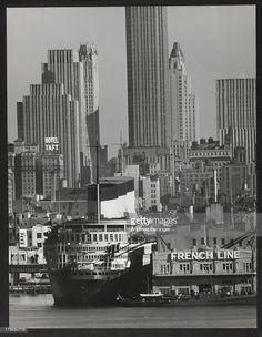 S.S. Normandie; in background Rockefeller Center; seen from the New Jersey Shore, New York, New York, 1941.