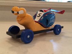 Turbo Pinewood Derby Car ~ lots of wooden balls and dowels sanded to create this car.  Q was a happy boy!