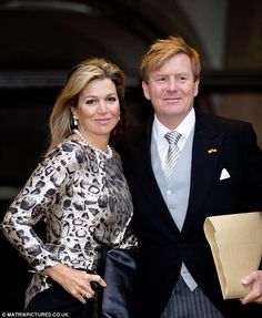 King Willem-Alexander, 47, opted for a morning suit with a striped silver tie which complimented Queen Maxima's silver animal print design for a New Years reception in Amsterdam, 14 January 2015.