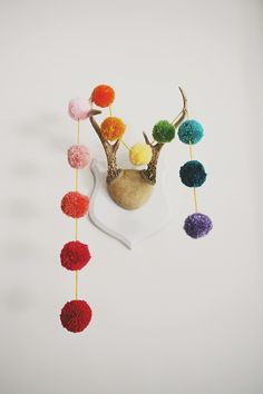 rainbow pom pom garland via seejaneblog, cute!