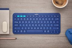 feiz design studio revitalizes round keys with universal logitech bluetooth keyboard Bluetooth Keyboard, Computer Keyboard, Wireless Speakers, Logitech, Id Design, Design Ideas, Graphic Design, Nintendo, Retro Stil