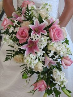 Traditional cascading bouquet of pink stargazer lily, pink sofie rose, white stock, stephanotis