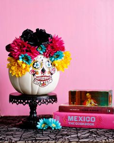 """Melodrama's household celebrates both Halloween and Dia de los Muertos. So she combined the two holidays by creating a Calaveras/Sugar Skull themed pumpkin. It looks super chic, and reminds us of the movie """"Book of Life.""""Pumpkin decorated by Krys Melo.Shop Martha Stewart Crafts"""
