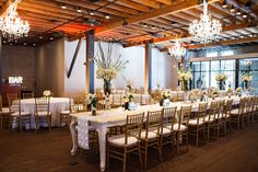 We love having our white venetian tables set up at Brazos Hall for a mix of elegance and industrial! White and Gold Wedding at Brazos Hall in Austin, TX. | Event Planner: Pearl Events Austin | Reception Venue: Brazos Hall | Ceremony Venue: St. Mary's | Caterer: Whole Foods Market Austin Culinary Center and Catering | Flowers: Megan Martinez | Cake: Sweet Treets Bakery & Cafe | Photographer: Jake Holt Photography |