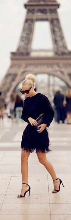 Chic fall fashion! Feathered mini skirt, black blouse and heels. Womens fall fashion clothing outfit for dates going out