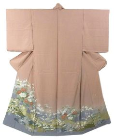 This is a Kimono fabric cut into Irotomesode shape and stitched roughly before sewing to make Houmongi