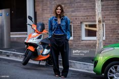 Christine Centenera wearing wide leg pants, denim jacket during Mercedes-Benz Fashion Week Resort 19 Collections at Carriageworks on May 17, 2018 in Sydney, Australia.
