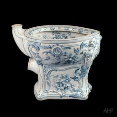 Stunning ornate blue and white toilet bowl https://www.etsy.com/listing/168249483/vintage-toilet-bowl-rudolf-ditmar-very