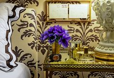 headboard, stenciled wall, table vignette