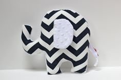 Baby Cagle would love this with a pink tail!  Modern Chevron Elephant pillow - nursery toy plushie - soft minky navy white. $28.00, via Etsy.