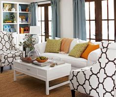 """Combining blue and brown is a go-to color palette. """"The way to update this classic pairing is to bring in bold leaf green, ivory, and citrus orange for your throw pillows. Every room needs a bit of citrus pop."""""""