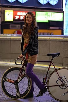 Yeah, she's cute, but look at the BIKE! If I were a fan of fixies, would build this exact ride. Love the HED front covered in stickers.