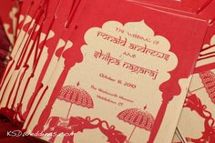 Red Wedding Program Booklets A picture of red and cream colored program booklets for a wedding taking place at the Wadsworth Mansion in Middletown, CT.