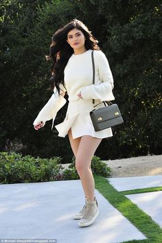 Here comes King Kylie! Jenner shows her stylish side in mini dress with two-part sleeves as she attends a meeting in Beverly Hills on Tuesday