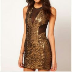ASOS Gold Sequin Mesh Mini Dress Worn once. Gold Sequin front with black mesh at waist & chest. Back solid black. Perfect for a night out on the town. ASOS Dresses Mini