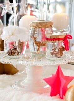 christmas table decor - glass jars with various small animal figurines