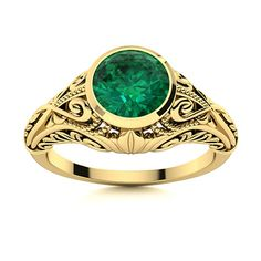 Delicate engraving and filigree lovingly embrace a stunning round brilliant cut stone on this incredibly detailed and intricate SI Diamond Emerald ring in 14k Yellow Gold in 14k White Gold. A subtle heart adorns either side, gracefully intertwining together. Slight Included (SI) diamonds are of fine quality and the standard in the American jewelry market. Natural Emerald Rings, Love Ring, American Jewelry, Shades Of Green, Vintage Rings, Ring Designs, Filigree, Diamonds, Delicate