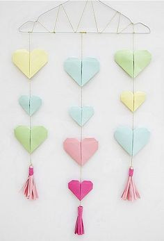 Origami Hearts Wall Hanging Tutorial With Paper Tassels is the perfect idea for DIY party decor year round. Make origami with patterned paper or a mix of metallics for a look that would be great for anniversaries, baby showers, weddings of birthdays. Origami Wall Art, Origami Fish, Diy Origami, Origami Paper, Decor Crafts, Diy Room Decor, Diy And Crafts, Paper Crafts, Mobiles