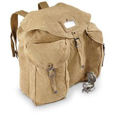"""Italian Military Surplus Cotton Canvas XL Rucksack/Backpack With Locking Chain, Used - Material: Cotton canvas, metal hardware Size: 18"""" x 18"""" x 6.5"""", each front pocket is 11"""" x 6"""" x3"""" This tough little Rucksack has plenty of power for hauling full loads of gear out to the most reclusive camp site. And it packs plenty of old-school cool doing it, sporting a heavyweight-grade military canvas and locking metal chain surplus backpack"""