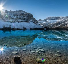 """""""Without deep reflection one knows from daily life that one exists for other people."""" - Albert Einstein  _  This shot of the mirror-smooth Bow Lake in Alberta Canada is a little late for #mondayblues - but hopefully it will inspire you for the coming week.  _  Out of all the beautiful places we saw in Alberta this would have to be my favourite. We pulled the car over on the side of the road and I slipped and slid down a steep snowy embankment to the water's edge to get as close as possible…"""